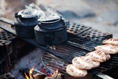 Coffee by the campfire Stock Images