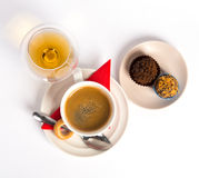 Coffee candies and cognac Stock Images