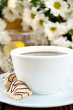 Coffee with candies, lemon water and white flowers Stock Photo