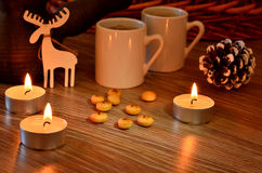 Coffee and candles on Christmas Stock Image