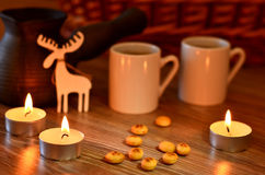 Coffee and candles on Christmas Royalty Free Stock Photos