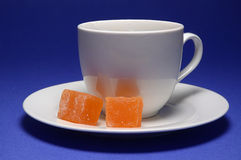 Coffee and candy. Still life with coffee cup and turkish delight candy Royalty Free Stock Photos