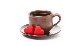 Coffee and candy in the the shape of heart for Valentine's Day Stock Photos