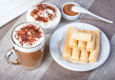 Coffee cappuccino chocolate chip and cinnamon waffle rolls and w Stock Photo