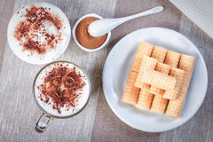 Coffee cappuccino chocolate chip and cinnamon waffle rolls and w Royalty Free Stock Image