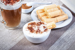 Coffee cappuccino chocolate chip and cinnamon waffle rolls and w Stock Images
