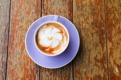 Coffee cappuccino closeup on wooden table Royalty Free Stock Photo