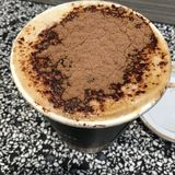 Coffee. Cappuccino on a cup with chocolate on top Royalty Free Stock Photos