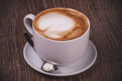 Coffee cappuccino cup with spoon Royalty Free Stock Photography