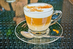 Coffee cappuccino in a glass cup. HDR picture Royalty Free Stock Image