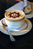Coffee cappuccino with pattern sun Royalty Free Stock Photo