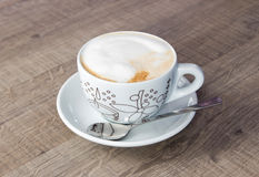 Coffee cappuccino. Photo on wood table Royalty Free Stock Photos