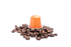 Coffee capsule. With coffee beans on white background royalty free stock image