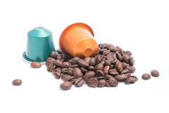 Coffee capsules. With coffee beans on white background royalty free stock photography