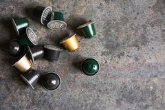 Coffee capsules on grunge background stock photography