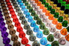 Coffee Capsules Multicolored Aranged In Rows Stock Photos