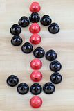 Coffee capsules in a shape of Dollar Sign Royalty Free Stock Photography