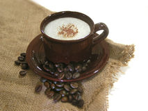 Coffee - Capuccino with beans. Capuccino with coffee beans Royalty Free Stock Images