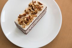 Coffee caramel cake on white plate.  delicious dessert with choc Stock Images