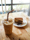 Coffee caramel frappe with whipped cream and Tiramisu cake Royalty Free Stock Images