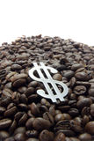 Coffee cartel. A mound of coffee beans on a white background, with dollar symbol on top Stock Images