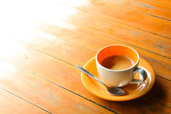 Coffee in ceramic orange cup Stock Image