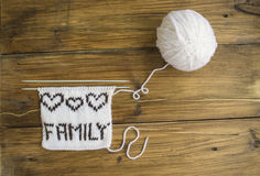 the inscription family is knitted of wool Royalty Free Stock Images