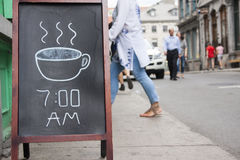 Coffee chalkboard sign outside cafe Royalty Free Stock Photo