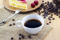 Coffee and cherry cheesecake with beans, delicious dessert on sa Royalty Free Stock Image