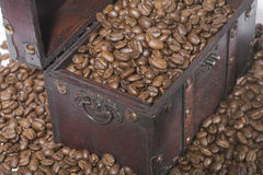 Coffee chest. A treasure chest with coffee beans Stock Photos
