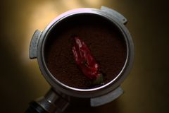 Coffee with chili pepper royalty free stock image