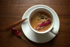Coffee with chilly pepper Stock Image