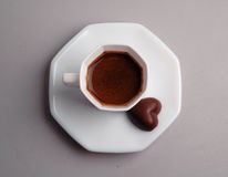 Coffee and chocolate. Cup of coffee and chocolate in the form of heart Stock Image