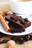 Coffee chocolate. Sweet coffee chocolate and cinnamon Stock Photos
