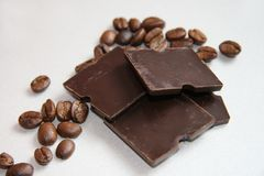 Coffee and chocolate. Coffee grains and slices of chocolate Royalty Free Stock Photography