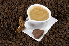 Coffee and chocolate. Cuo of espresso coffe with heart shaped chocolate candy Stock Photography