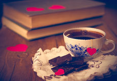 Coffee and chocolate, in the background of the heart. Royalty Free Stock Images
