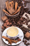 Coffee with Chocolate bar and spices Royalty Free Stock Photo