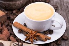 Coffee with Chocolate bar and spices Stock Image