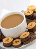 Coffee with chocolate biscuits. Cup of coffee or hot chocolate with delicious chocolate biscuits royalty free stock photography