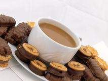 Coffee with chocolate biscuits. Cup of coffee or hot chocolate with delicious chocolate biscuits stock photos