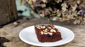Coffee and Chocolate Brownie. Put on a wood table with dark roasted coffee beans Stock Image