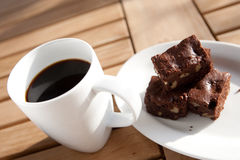 coffee with chocolate brownie on side. Stock Photo