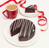 Coffee and chocolate cake. A chocolate cake for all to share Royalty Free Stock Photo
