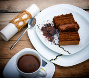 Coffee and chocolate cake. In moments of enjoyment royalty free stock photography