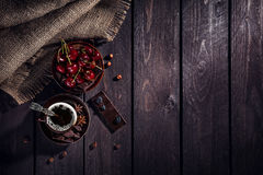 Coffee, chocolate and cherry Stock Photos