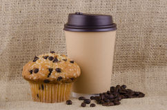 Coffee and chocolate chips muffin Royalty Free Stock Photos