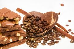 Coffee, chocolate and cinnamon sticks. Isolated on the white background Royalty Free Stock Photography