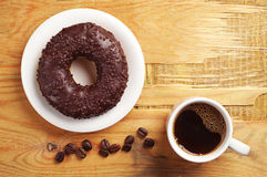 Coffee and chocolate donut Stock Images