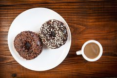 Coffee and chocolate donuts Stock Photos